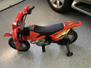Mini Moto kid's 6V electronic motorcycle with training wheels for Sale in Orlando, FL