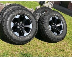 "18"" Dodge Ram Rebel 2019 1500 Black Factory OEM wheels rims tires A/T tires for Sale in Solana Beach, CA"