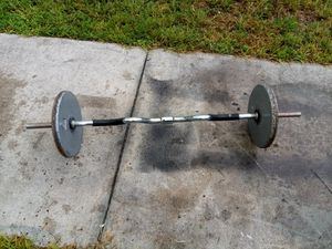 Steel curl bar with 50 lb weights for Sale in Hollywood, FL