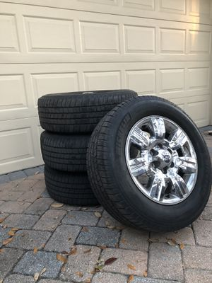 Ford F-150 wheel and tire package. Chrome rims, 265/60r18 tires, comes with bolts. for Sale in Orlando, FL