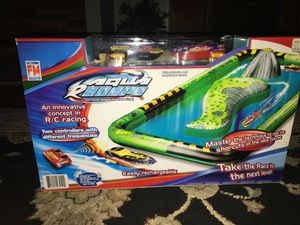 Exiting speed boat racing!, inflatable course to race remote controlled boats. for Sale in Round Lake, IL