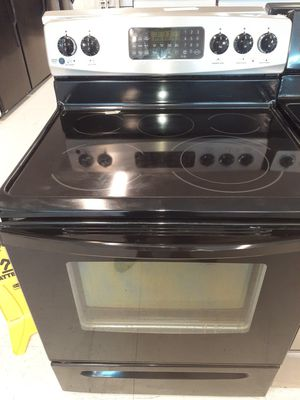 Kenmore stove electric good condition 90 days warranty for Sale in Mount Rainier, MD