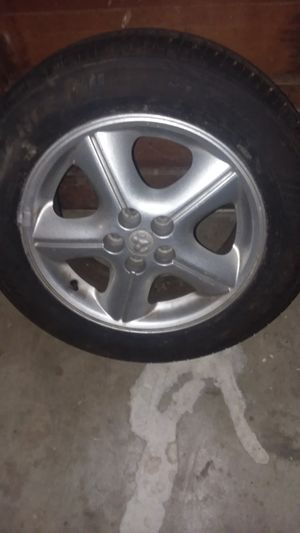"16"" Dodge rim and NEW tire for Sale in Nineveh, IN"