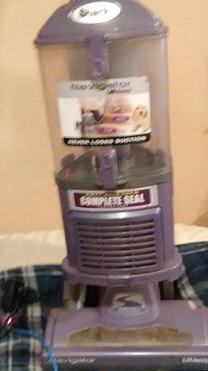 A navigator Shark vacuum has a hose and it works good very good for Sale in Modesto, CA