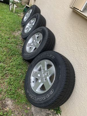 Jeep jk wheels and tires good year for Sale in Pembroke Pines, FL