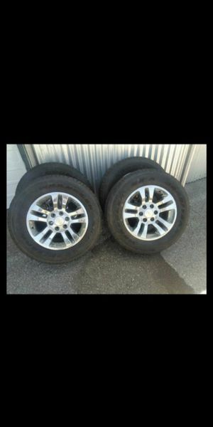18` factory Chevy chrome wheels with Goodyear tires for Sale in San Antonio, TX