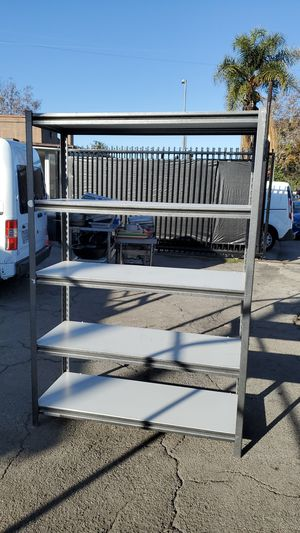 5 tier shelves, metal frame and compressed wood. for Sale in Los Angeles, CA