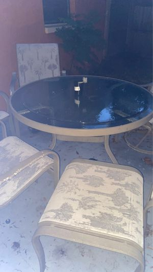 Patio set 7 chairs and 2 ottoman type seats with glass table for Sale in Port Richey, FL