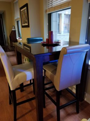 """40"""" X 40"""". Tall. 3'.7"""" table, glass top, and 4 Bar heighth Chairs. $600.00 marked Down to $500.00. for Sale in St. Louis, MO"""