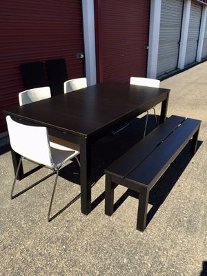 Extendable Black/ brown dining table Set with bench with 4 white genuine leather chairs for Sale in San Diego, CA