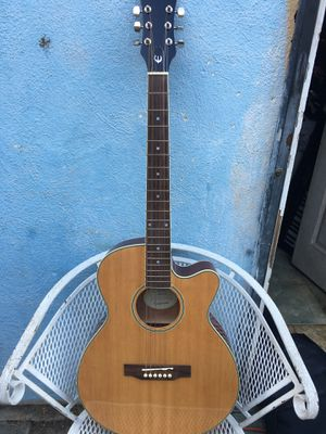 Epiphone Acoustic electric guitar has a little dent, comes with cover sounds really nice for Sale in Fullerton, CA