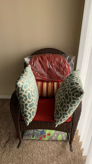 Wicker Rocking patio chair and 3 decorative pillows for Sale in Maineville, OH