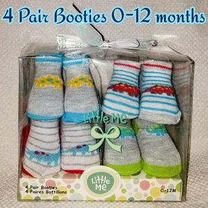 4 Pair Dinosaur Baby Boy Booties 0-12 months for Sale in Bolingbrook, IL