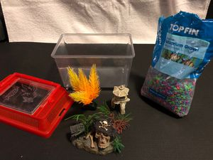 Small Fish Tank with Mulicolor Aquarium Gravel and 3 Decorations (Pirate Skull, Yellow Plastic Plant, Rock Structure) for Sale in Burbank, CA