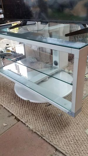 GLASS TOP TV STAND ( SWIVEL BASE ) for Sale in Arcadia, CA