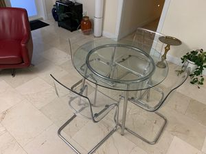 IKEA 4 Tobias chairs and round glass chrome Salmi dining table for Sale in North Miami Beach, FL