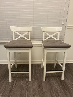 "Quantity 2 Pre-owned IKEA White Counter Stools/chairs (comes with gray seat cushions) Approximate Dimensions Seat height 25"" Back rest height: 36"" for Sale in Peabody, MA"