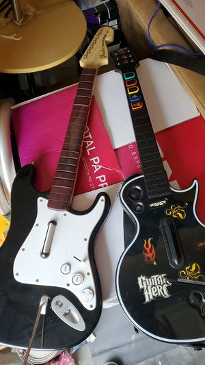 ROCK BAND FENDER STRATOCASTER & GIBSON GUITAR HERO Sony playstation guitar FOR PARTS ONLY both for $25 for Sale in Clovis, CA