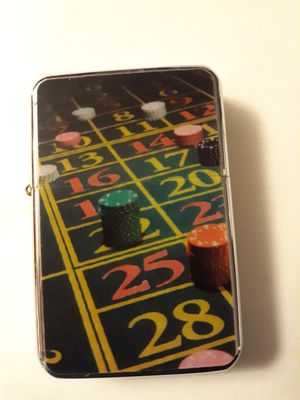 New Gambling Roulette table stacked chips windproof oil lighter similar to zippo for Sale in Lancaster, OH