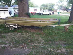 16' wide bottom Jon boat w/trailor. 9.9 motor not getting fire, no title for motor have to file for lost for Sale in Center, MO