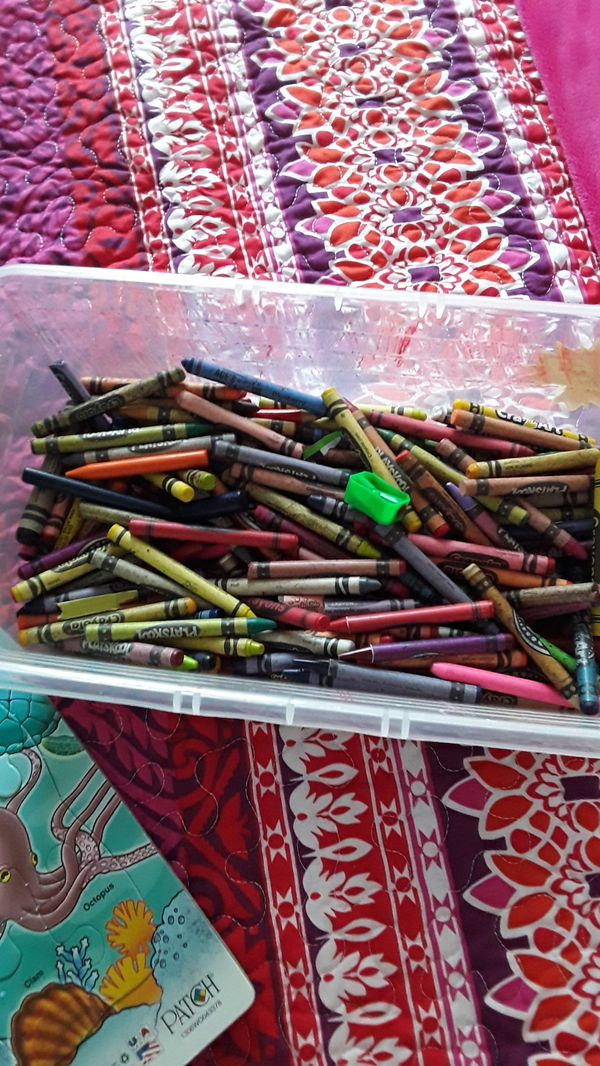 puzzles, board game and box full of crayons