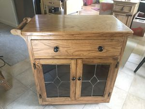 Oak kitchen cart cabinet with towel rack for Sale in Arvada, CO
