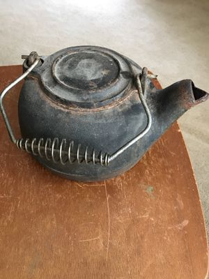 Antique Cast Iron Kettle with attached Lid and Spiral Metal Handle that are both still very Secure. Over 75 Years Old. Pick up in East Clayton today for Sale in Clayton, NC
