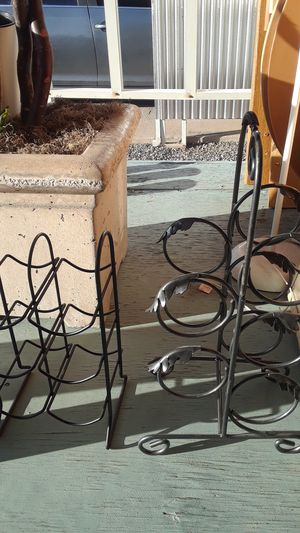 2 metal wine racks and a magazine rack not taking offers! for Sale in Glendale, AZ