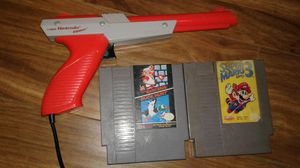 Classic Nintendo NES Games and Duck Hunt Zapper for Sale in Los Angeles, CA