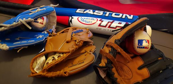 Kids baseball gear, 3 gloves, 2 bags, 1 helmet 2 bats, 2 balls