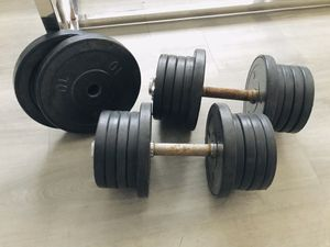 Two adjustable dumbbells with set of weights . for Sale in Hialeah, FL