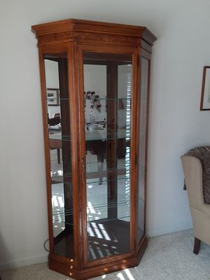 Curio cabinet with inside light for Sale in Fresno, CA