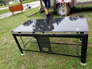 TV stand black glass and a shelf on the bottom for Sale in Lakeland, FL