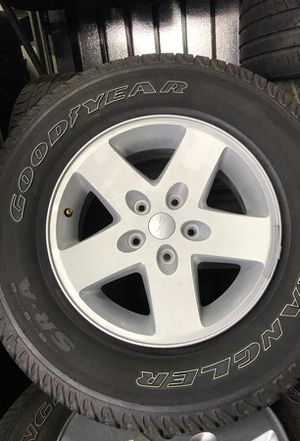 Jeep Wrangler wheels 5 rims and tire like new for Sale in San Bernardino, CA