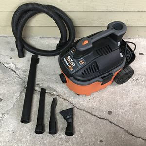 RIDGID 4 Gal. 5.0-Peak Portable Wet/Dry Shop Vacuum with Accessories for Sale in Houston, TX