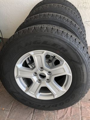 Jeep Wrangler 2019 wheels and tires Goodyear wrangler All terrain adventure 245/75/17 for Sale in Hialeah, FL