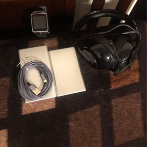 2portable Charge 1smart watch 1-iPhone charger 1 Gaming headset with a mic and A wireless headphones for Sale in San Diego, CA
