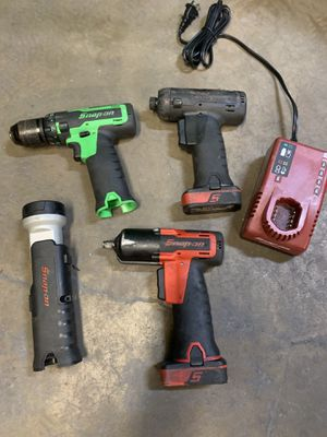 Snap on 14.4v lithium ion 3/8 impact, driver, drill, batteries and charger for Sale in San Diego, CA