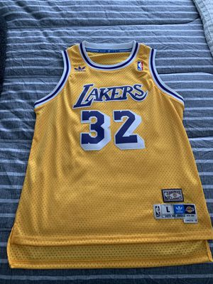 Lakers magic Johnson jerseys gold size large kids 100% authentic for Sale in Los Angeles, CA