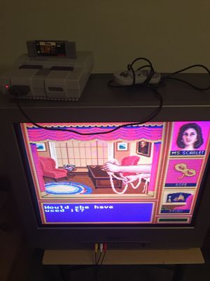 Super Nintendo snes game with two controllers + TV Magnavox old flat screen for Sale in Columbus, OH
