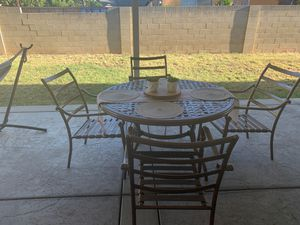 3 sets in total , 1 Set A beautiful table and 4 chairs 2 set a love 💕 seat 2 chairs and a beautiful center table 3 set a patio bar whit 4 high chairs for Sale in Riverside, CA