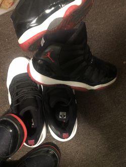 $300$250For Both OBO 7youth AIR JORDAN 11 RETRO 'BRED' And Air Jordan 11 Retro Low for Sale in Stratford,  NJ