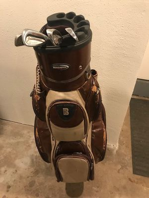 Old School Golf bag with a few misc clubs. for Sale in Portland, OR