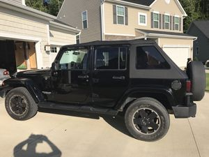 Jeep Wrangler rims and tires. for Sale in North Ridgeville, OH