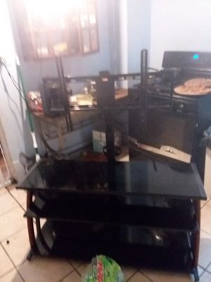 3 tier glass TV stand with swivel and tilt TV mount up to a 70 in tv for Sale in Peoria, IL