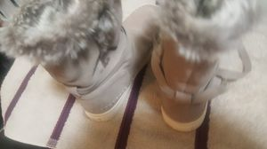 Boots ... toms.... size 7 w.. tan with white soles...tan n grey fur.... size 7w for Sale in Madison Heights, VA