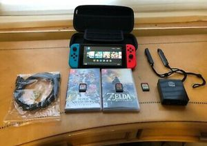 Nintendo Switch Console with Zelda BOTW Super Smash Bros Ultimate Mario used V2 for Sale in Metairie, LA