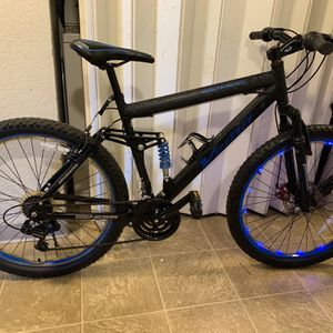 "Genesis 26"" V2100 Aluminum Black/Blue Men's full Suspension Mountain Bike fit up to 6ft1 tall. for Sale in Sacramento, CA"