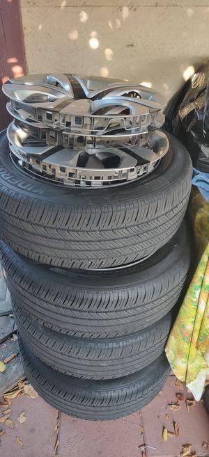 Honda oem tires and rims hub cap for Sale in Los Angeles, CA