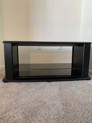 Black Television Stand with glass shelves for Sale in Manassas, VA